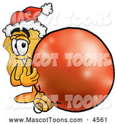August 6th, 2013: Mascot Cartoon of a Cheerful Badge Mascot Cartoon Character Wearing a Santa Hat, Standing with a Christmas Bauble by Toons4Biz