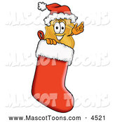 Mascot Cartoon of a Police Badge Mascot Cartoon Character Wearing a Santa Hat Inside a Red Christmas Stocking by Toons4Biz